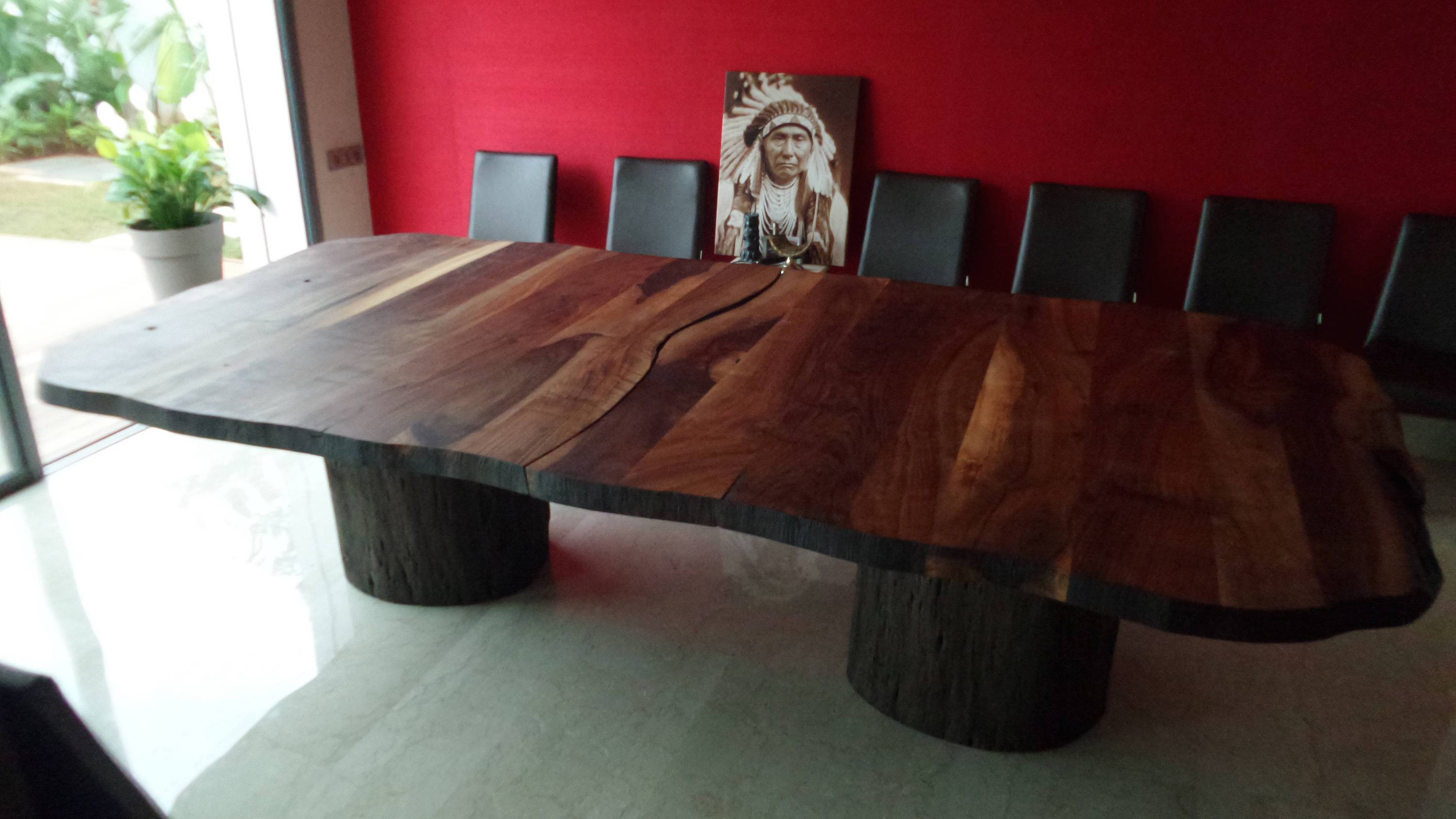 Walnut and natural wood dining table