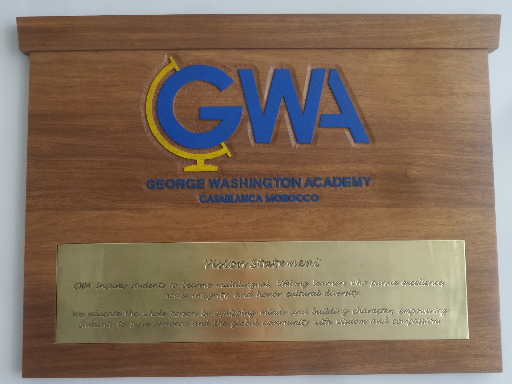 GWA Mediatech - handcarved wood & brass sign